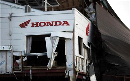 A Honda sign is seen at a building damaged by the March 11 tsunami in Kesennuma town